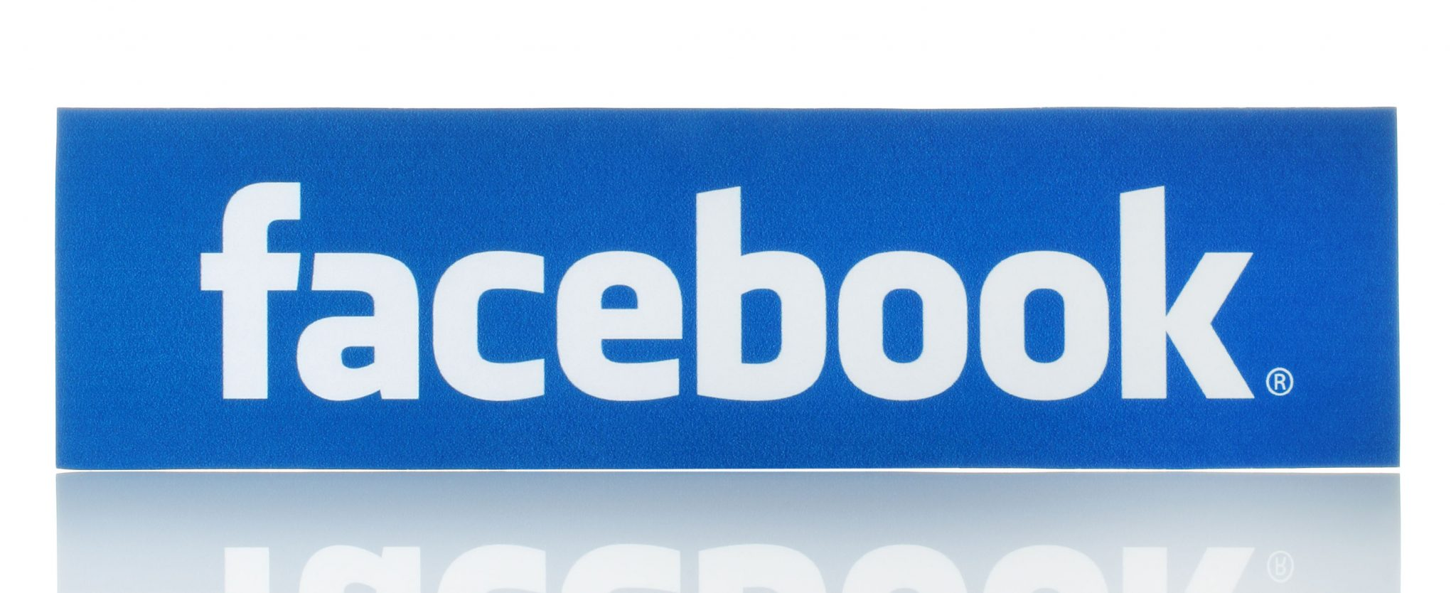 37759329 - kiev, ukraine - february 19, 2015:facebook logo sign printed on paper and placed on white background. facebook is a well-known social networking service.